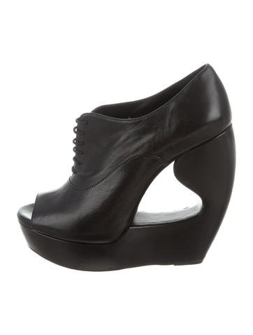 Alaïa Lace-Up Wedge Booties None