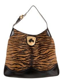 89b561bab3bcc Alexander McQueen. Ponyhair Shoulder Bag. $345.00 · Alexander McQueen.  Embossed Leather Mini Tote