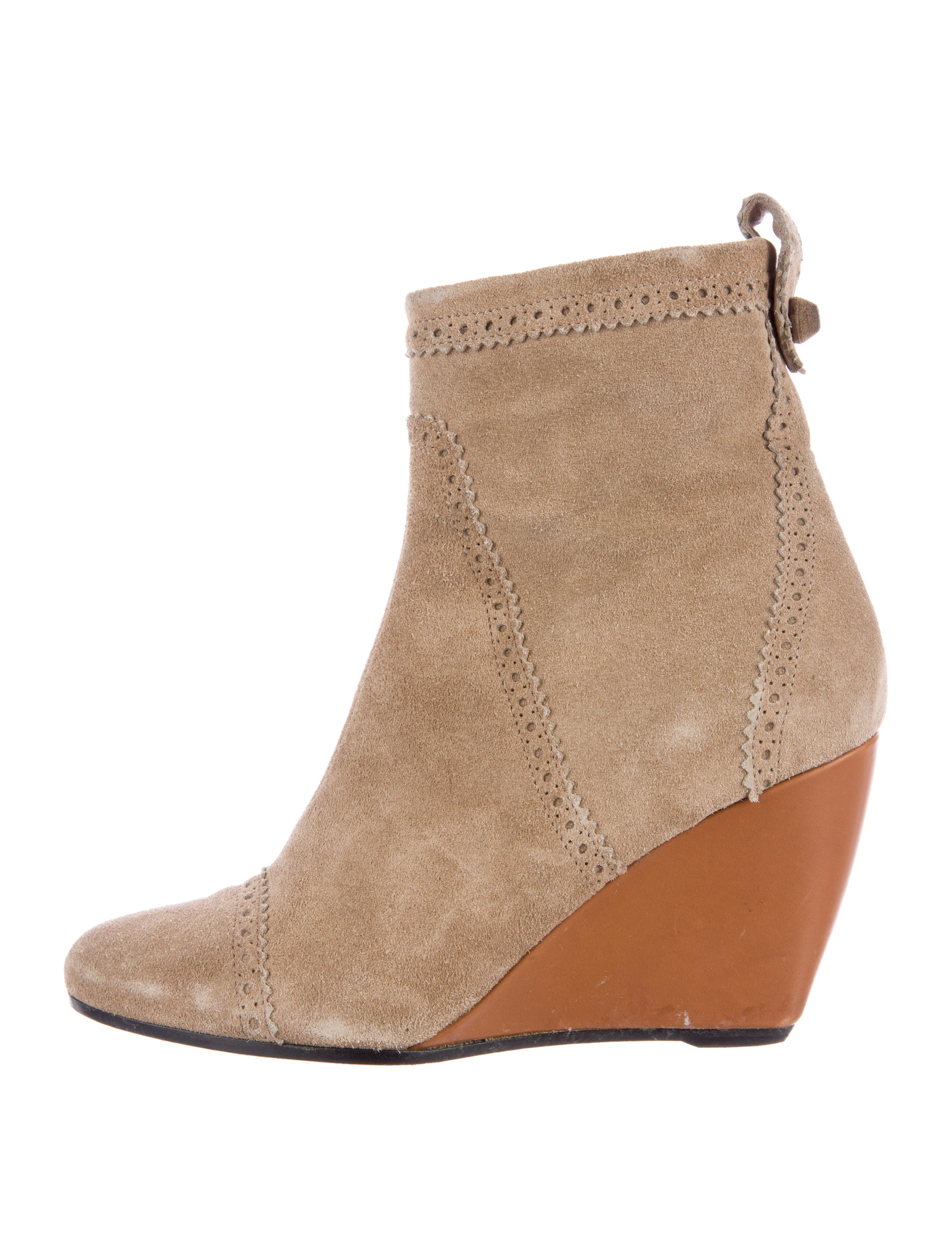 Strap To It Pointy Buckled Booties To Cap It Off Faux Suede Combat Boots Zip Line Chunky Faux Suede Booties GoJane has you covered with flat ankle booties that still look totally on fleek. Try a pair of low wedge booties with just a slight lift, or go for the gold in a pair of metallic sneaker booties that have that athleisure look totally.