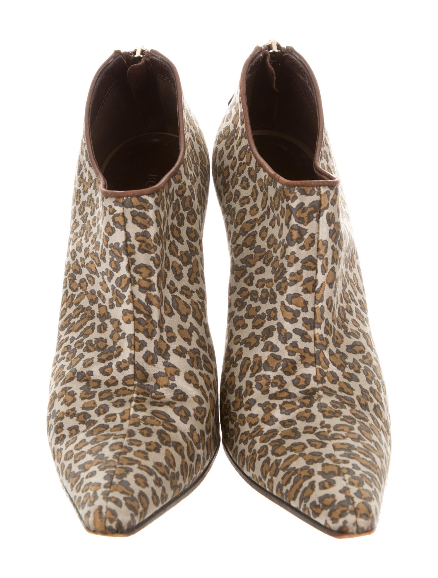 Product Features Ankle boot in animal-print fur with instep zipper and concealed wedge heel.