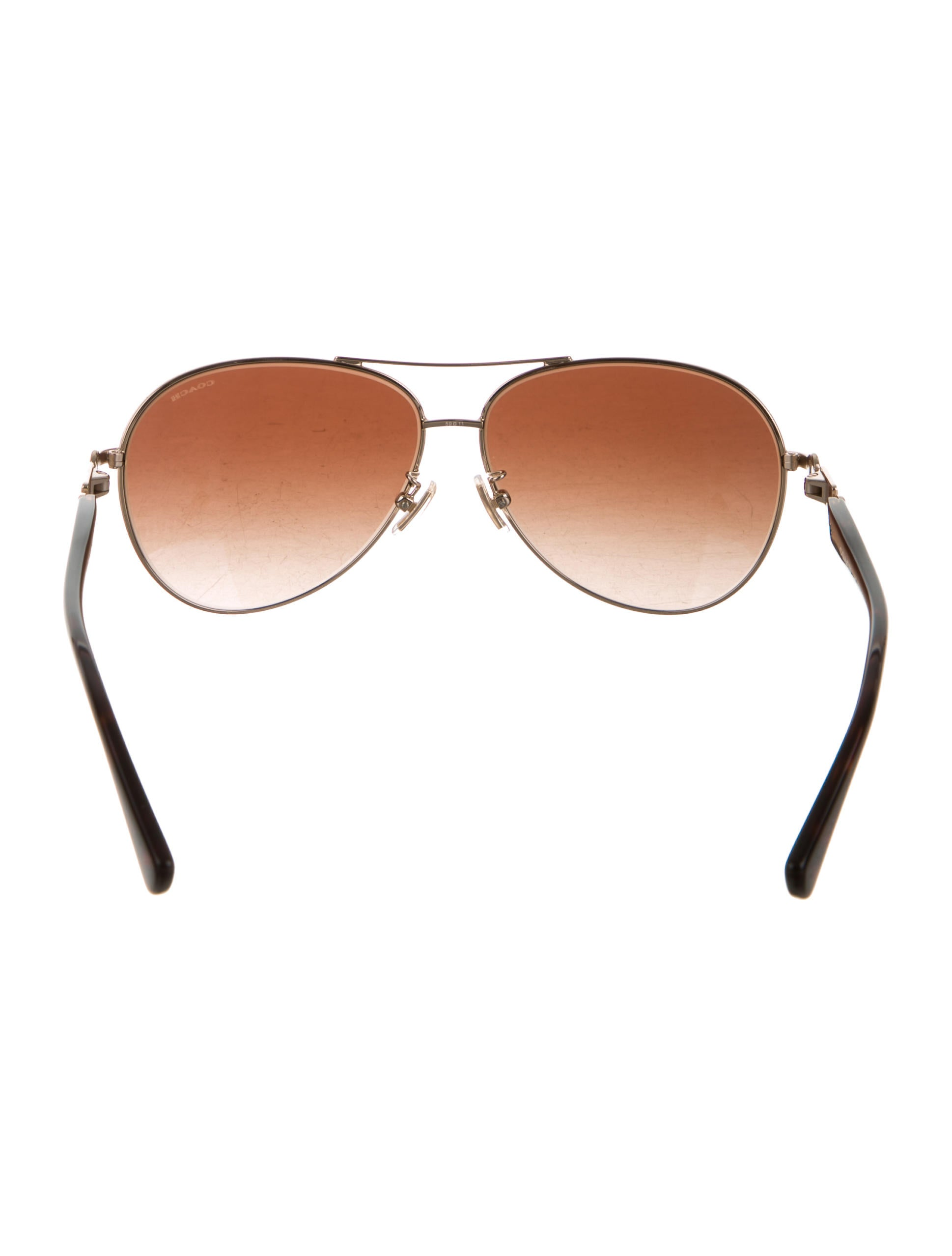 c15a0b8e6a7 Coach Aviator Polarized Sunglasses