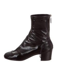 1b58a2695c58 Chanel. CC Cap-Toe Ankle Boots