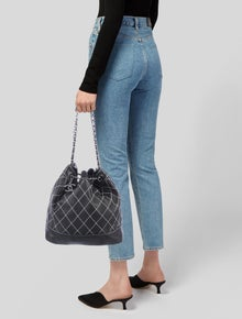 72bc45b5997c Chanel. Surpique Drawstring Bucket Bag