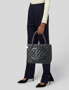 1a4c2d0efbec Chanel. Caviar Medallion Tote. Est. Retail $2,400.00. $1,325.00 · Chanel.  CC Snakeskin Wristlet. $1,545.00 · Chanel. Vintage Quilted Mini Shoulder Bag