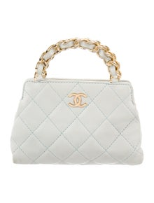 4fb20eab09ad46 Chanel. Quilted Mini Handle Bag