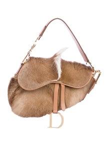 bb04b68326 Christian Dior. Ponyhair Oblique Saddle Bag