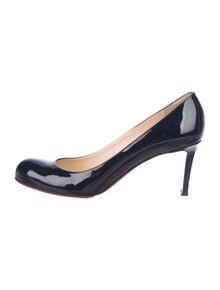 5ee8aa8df2a Christian Louboutin. Patent Leather Round-Toe Pumps