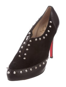 f10a354922cf Christian Louboutin. Platform Spiked Booties