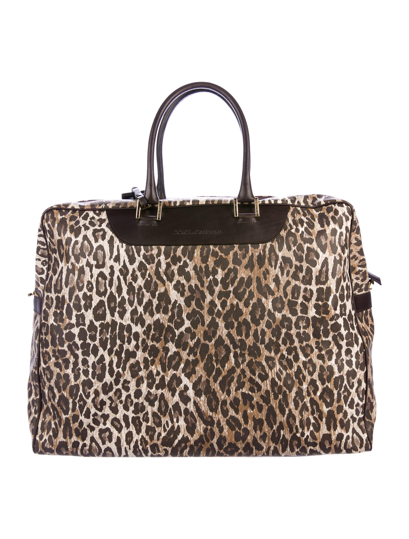 9cb514930b0a Dolce   Gabbana Leather-Trimmed Coated Canvas Duffle Bag - Handbags -  DAG101055