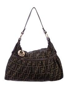 9d1cd74ee1a8 Zucca Handle Bag.  495.00 · Fendi
