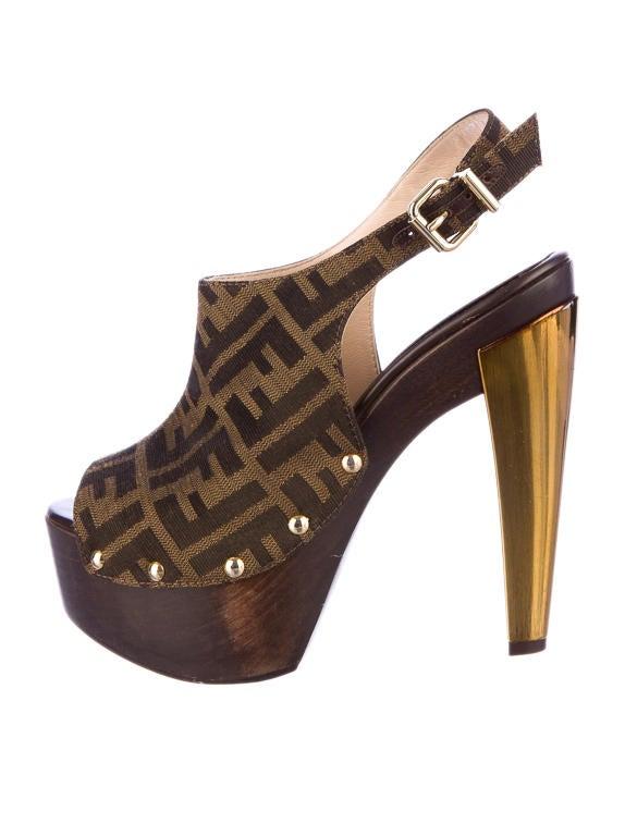 badb316c960a1e Fendi Zucca Platform Clogs - Shoes - FEN10464