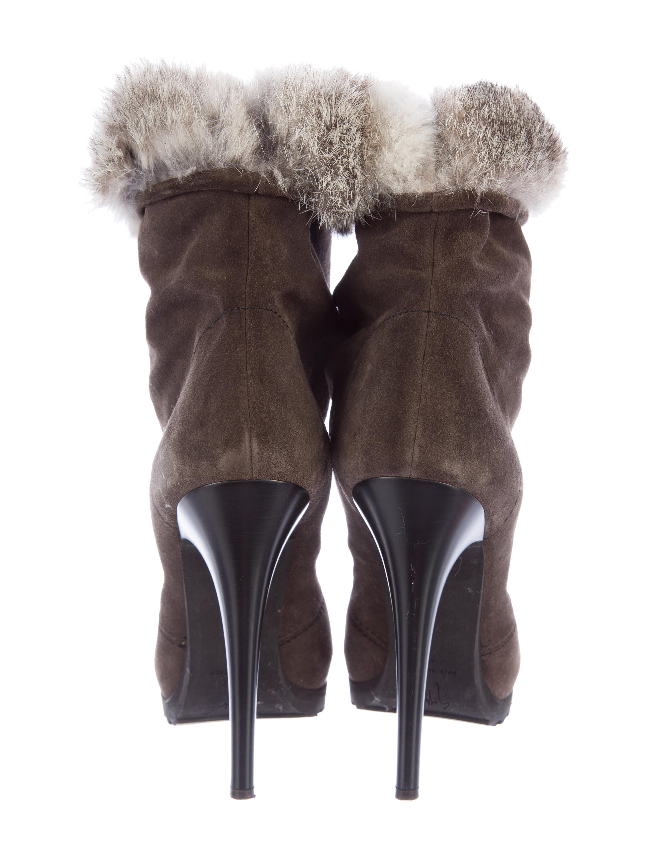 Black leather and mink fur trim ankle boot from Christopher Kane featuring a pointed toe, a mid high stiletto heel, a fur trim, a rear zip fastening and a brand embossed insole.