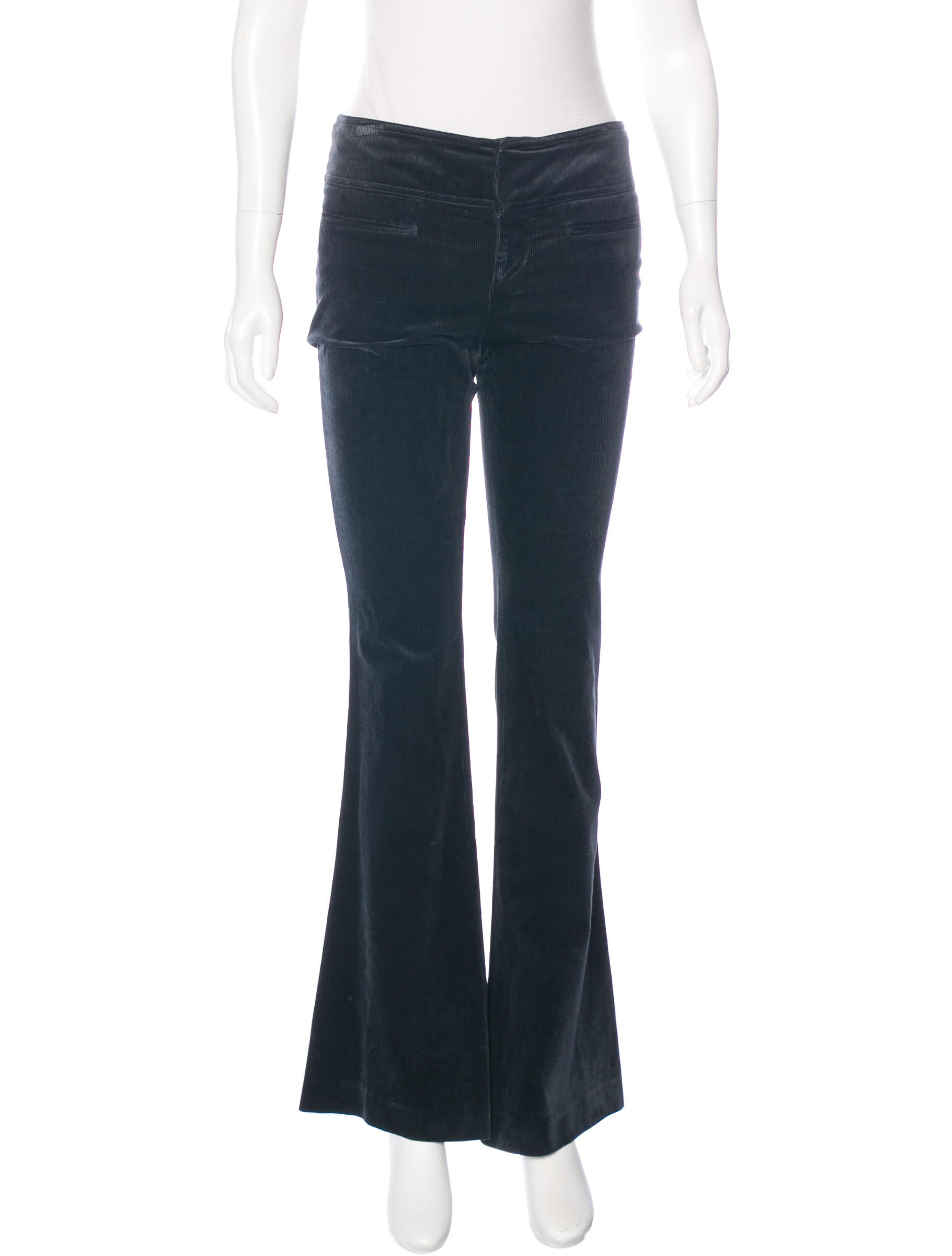Wide leg corduroy pants with paper bag waist styling, raw-edged trims, a removable waist-tie belt, and exposed front zip closure. Gold-tone hardware on zip, with ring pull tab. Belt loops. Side pockets.