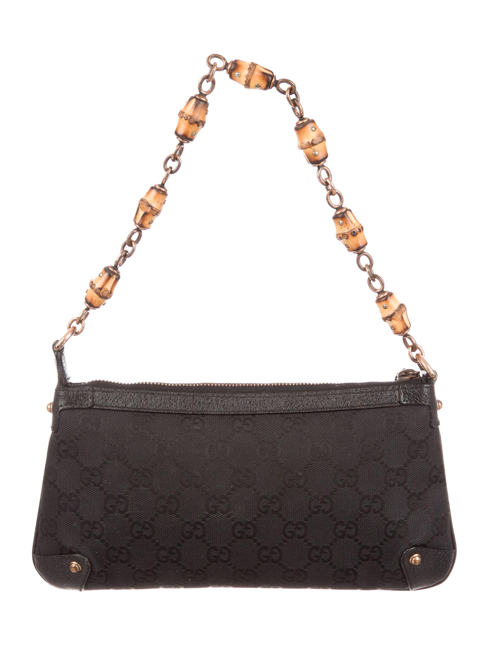 gucci gg canvas pochette handbags guc136274 the realreal. Black Bedroom Furniture Sets. Home Design Ideas