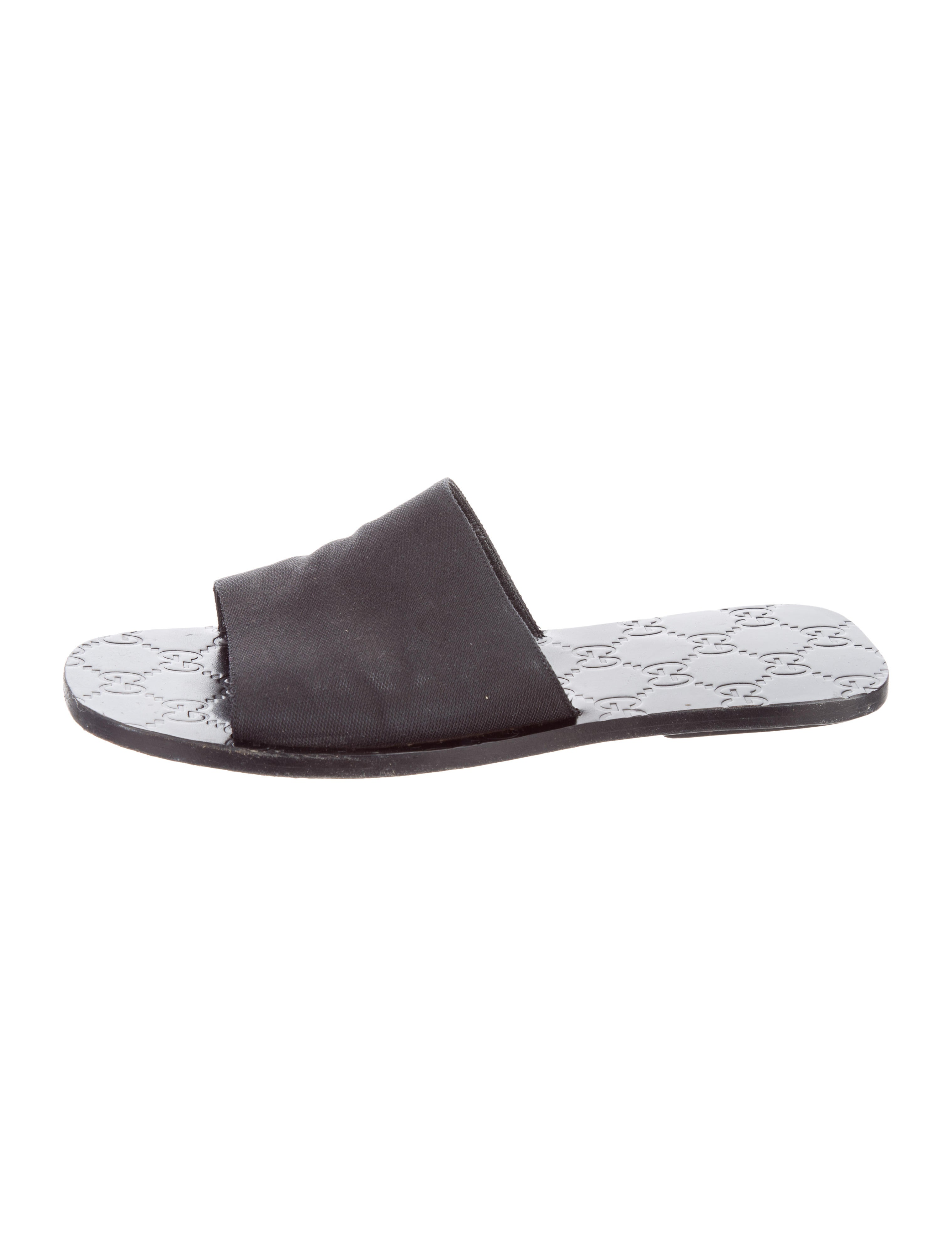 The shoe is constructed with a soft, flexible two-tone canvas upper with frayed edging details, dual goring panels, and ventilation holes on the side to keep feet cool and dry.