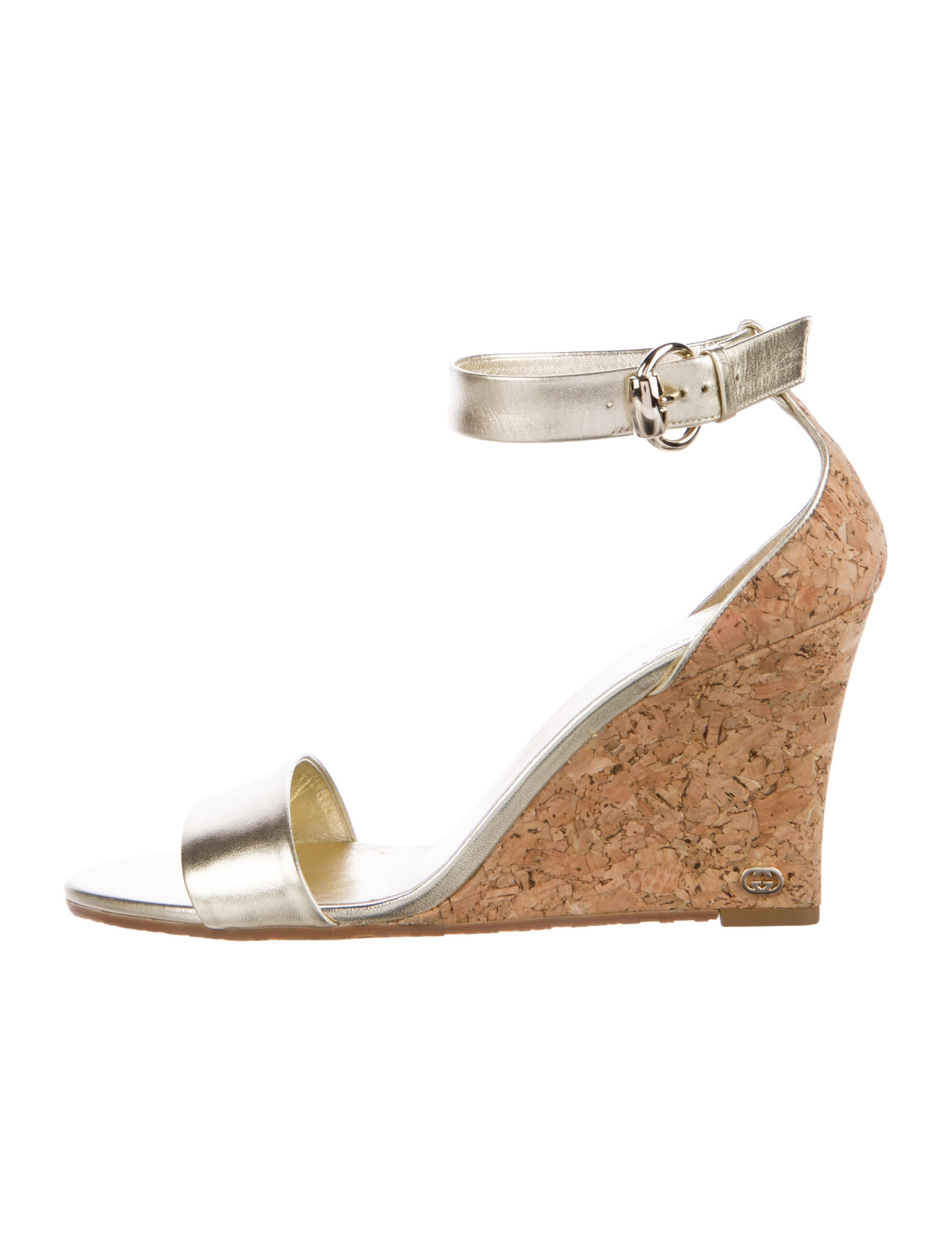 ff5aa181c93ef7 Gucci Metallic Leather Wedges - Shoes - GUC164646