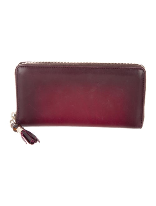 09ac8730d2f5 Gucci Bamboo Tassel Zip-Around Wallet - Accessories - GUC172782 ...