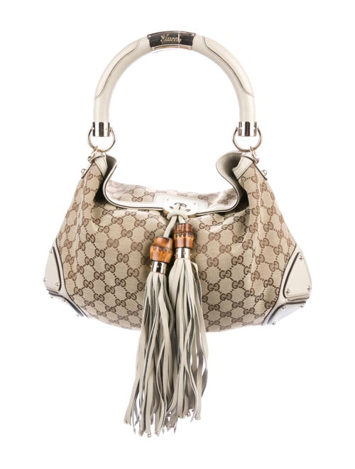 b02402d45cf Gucci GG Canvas Medium Indy - Handbags - GUC285535
