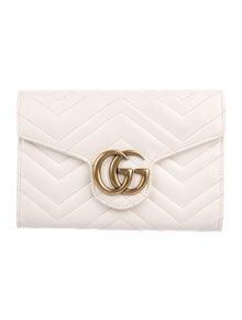 82752e83854 Gucci Clutches