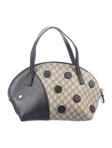 26814e8b9ec Gucci. GG Supreme Ladybug Bag