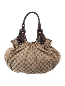 5a6bd123e89 Gucci. Studded Medium GG Pelham Shoulder Bag