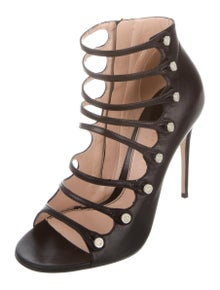 99cae00b43e Gucci. GG Cage Sandals