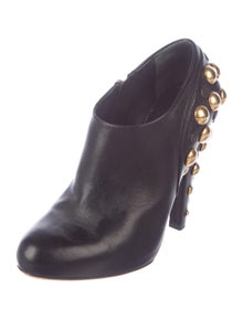 0648ecf50c2 Gucci. Studded Leather Booties