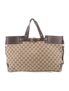 a907019ed7e5 Gucci. GG Canvas Buckle Tote
