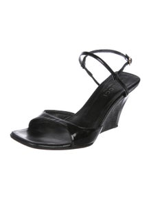 c74626036e5 Gucci. Patent Leather Wedge Sandals