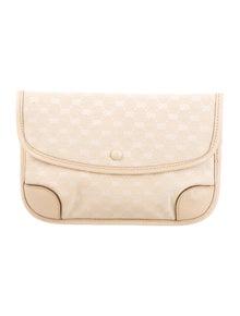 eaddda0134a5 GG Canvas Cosmetic Pouch. $195.00 · Gucci