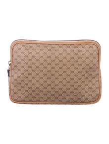 9f26617ea357 Vintage Micro GG Plus Pouch. $195.00 · Gucci