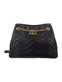 400609a12173 GG Marmont Mini Top Handle Bag. Est. Retail $1,980.00. $1,325.00 · Gucci