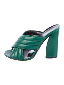 bc1ecf2c7 Gucci. Leather Slide Sandals