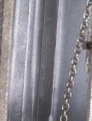 Lamberston Truex Metallic Karung Clutch