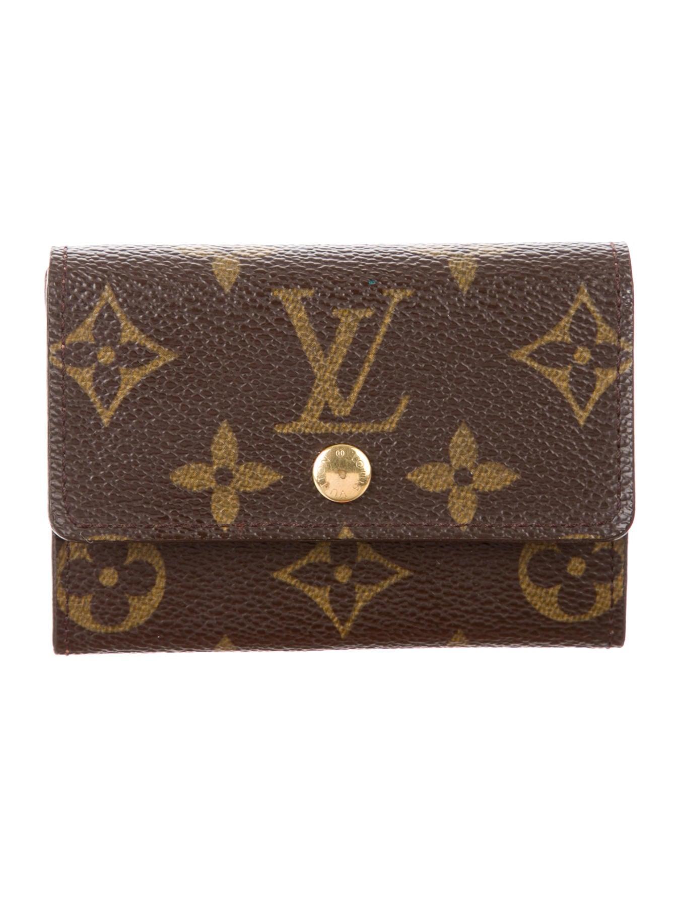 louis vuitton monogram porte monnaie plat change purse accessories lou116572 the realreal. Black Bedroom Furniture Sets. Home Design Ideas