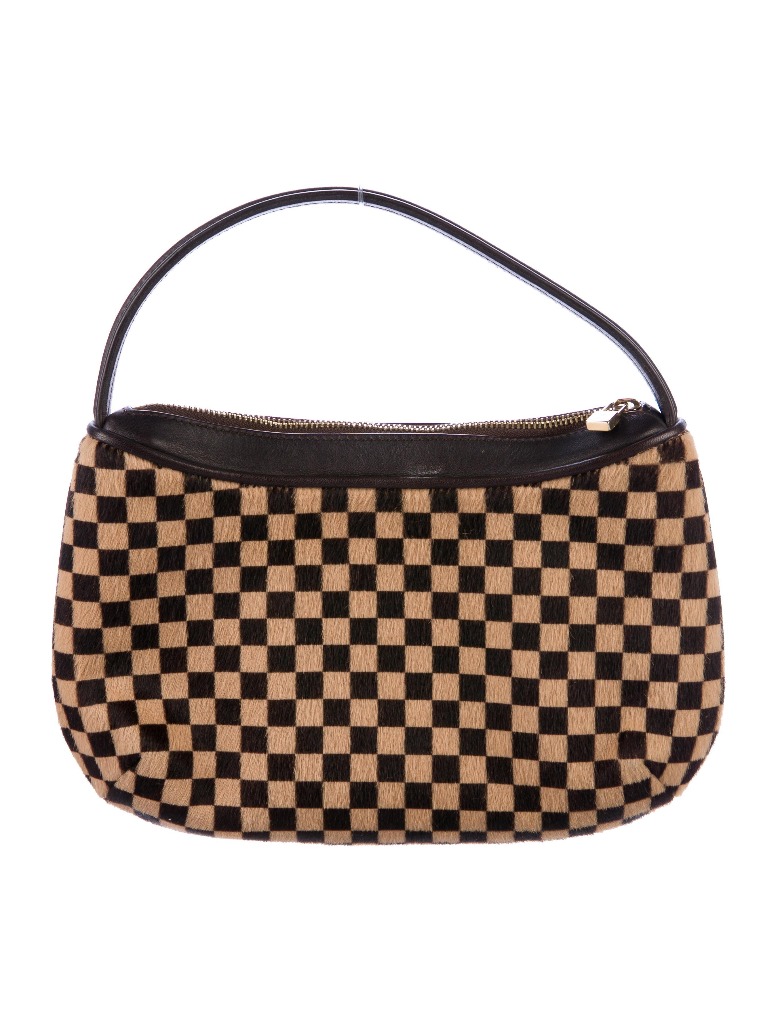 9aee70e58324 Louis Vuitton Damier Sauvage Tigre Bag - Handbags - LOU139351