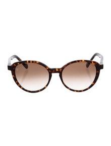 75c00aaf0a89 Louis Vuitton. Ava Round Sunglasses
