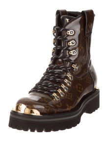 52e606aaaa11 Louis Vuitton. Outland Ankle Boots