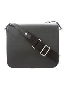 a8355cb3907d Louis Vuitton. Taiga Andrei Messenger Bag