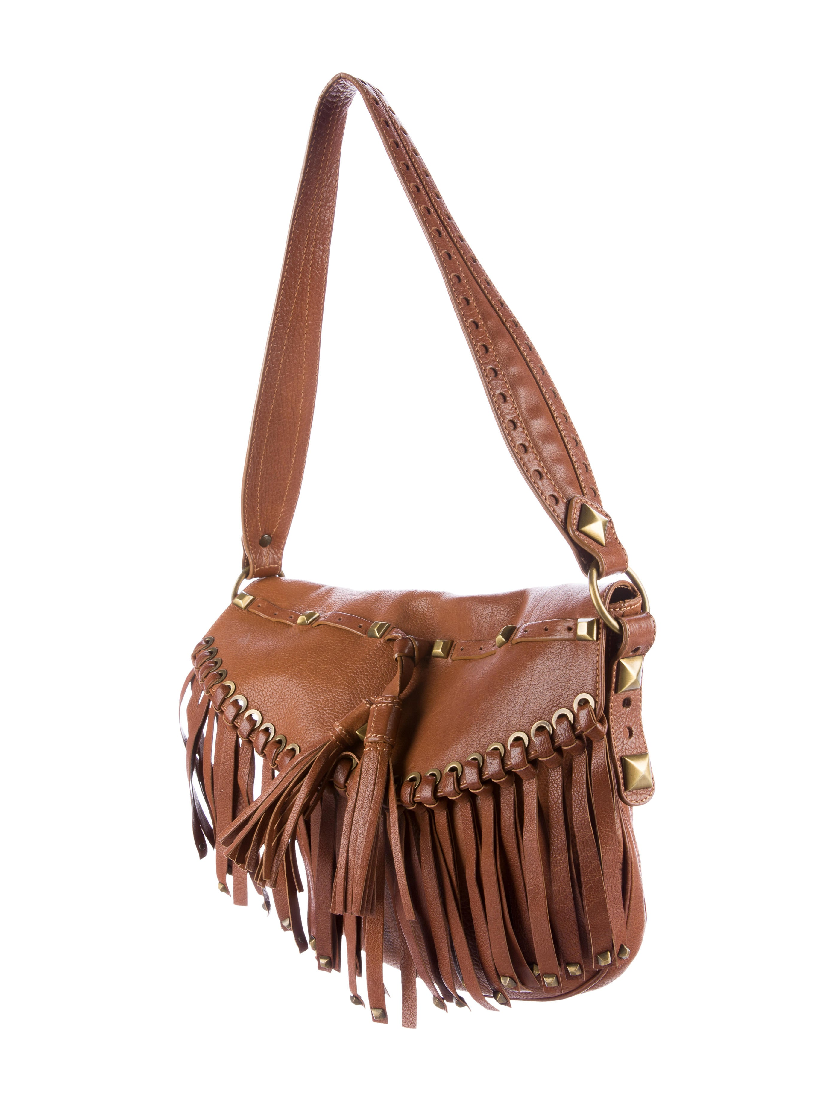 Travel lightly with this tech-savvy handbag. Fringe-trimmed metallic leather opens to reveal card slots, a coin pocket, and special place just for your phone. It's the ultimate party companion.