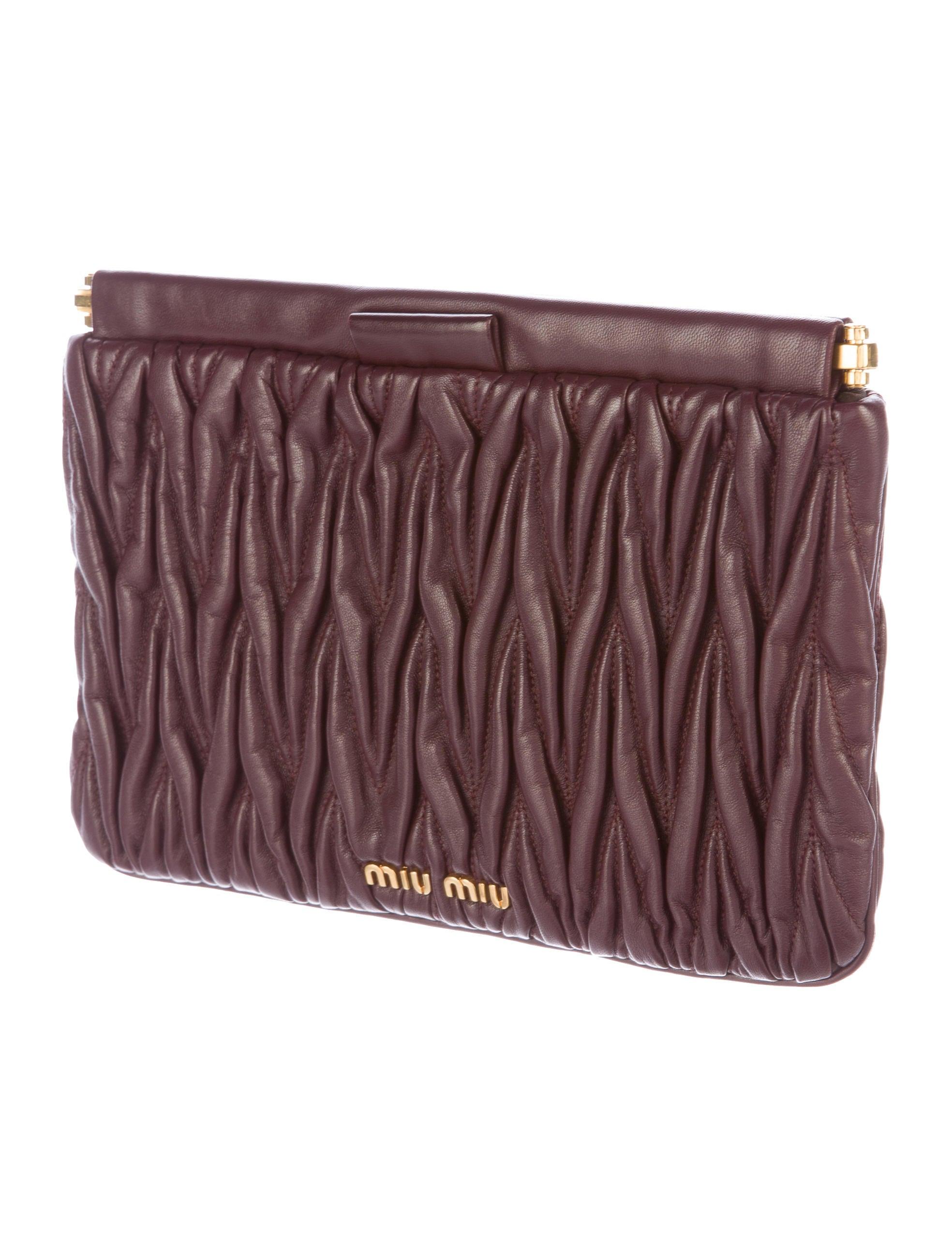 miu miu matelass leather clutch handbags miu47286 the realreal. Black Bedroom Furniture Sets. Home Design Ideas
