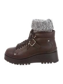 c57661aa8d31 Miu Miu. Leather Round-Toe Boots ...
