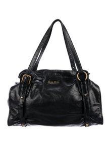 7059f991a34 Miu Miu. Leather Drawstring Tote