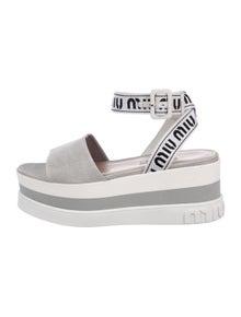 38c7826a9f43a Miu Miu. Flatform Logo Sandals. Size: US 7.5 ...