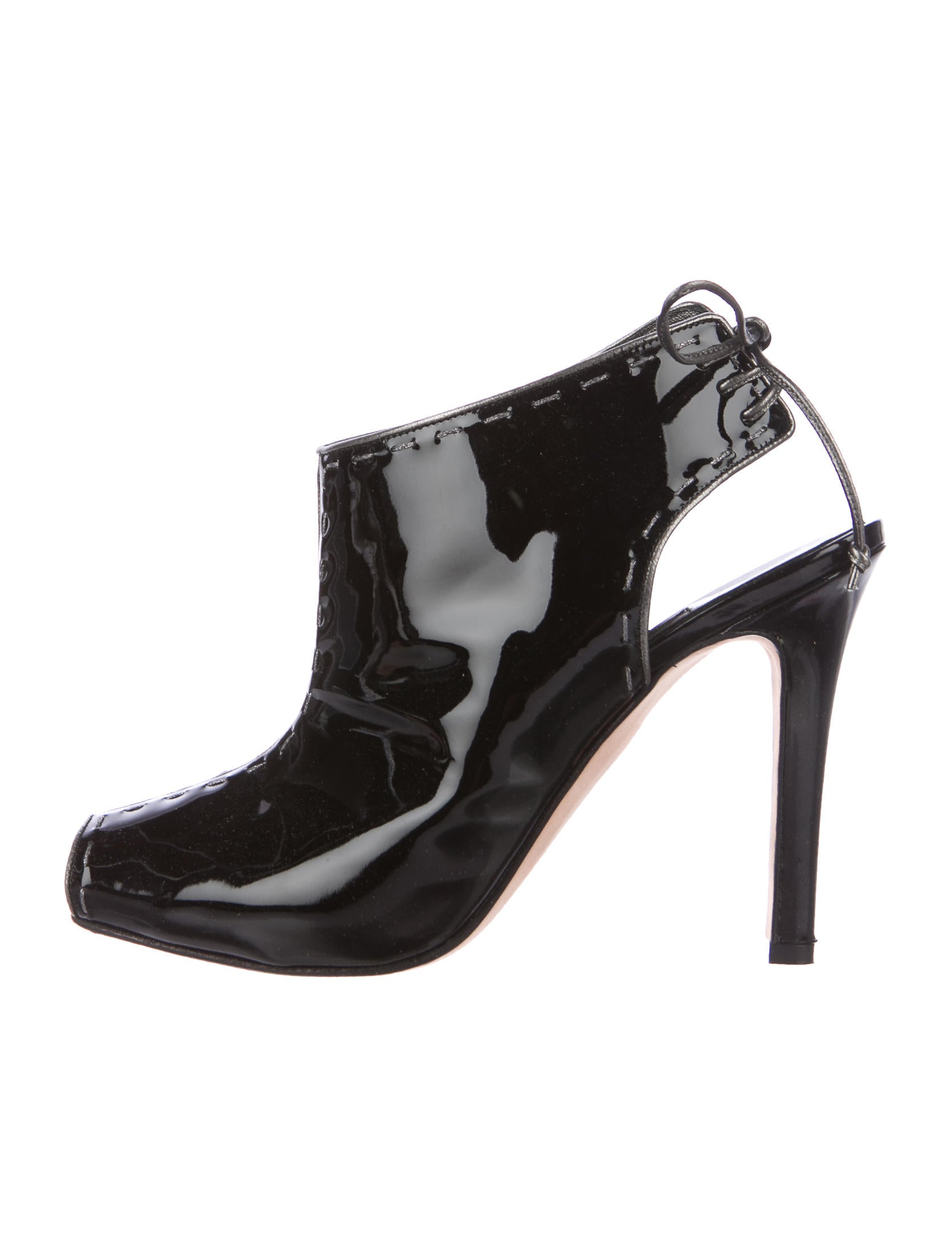 These knee high patent leather boots lace up the front. They have a 2