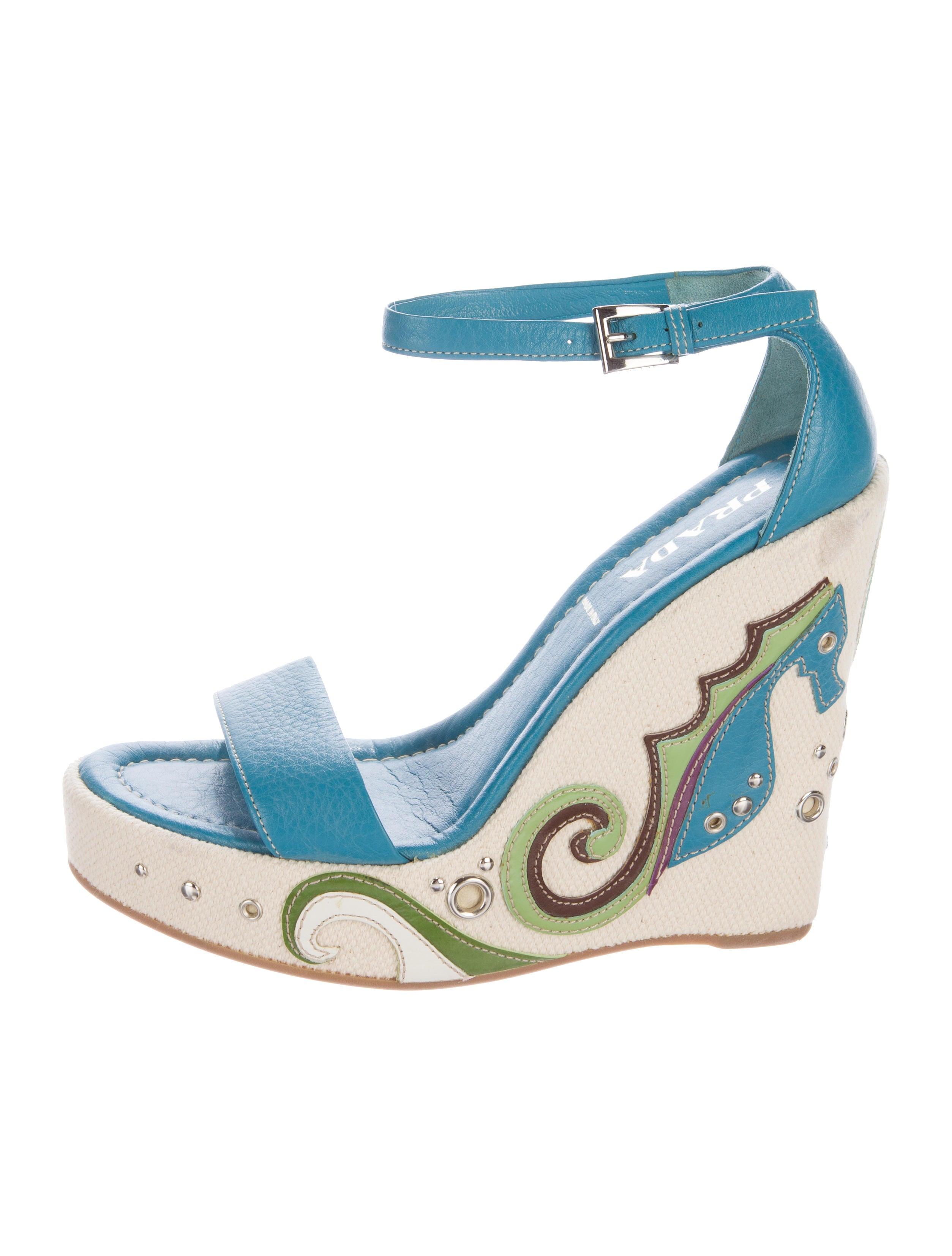 a6d41acb1 Prada Seahorse Wedge Sandals - Shoes - PRA135670