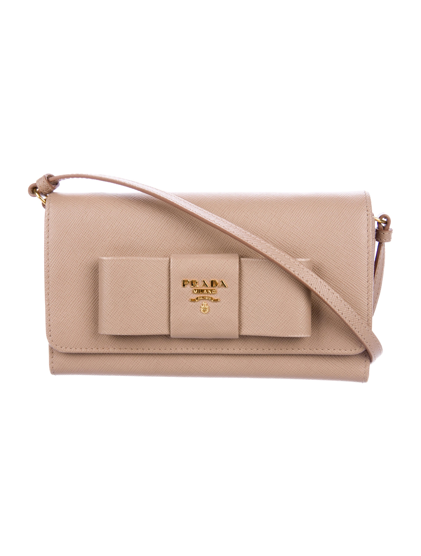 ae4769812fbcb8 Prada Saffiano Lux Bow Crossbody Wallet - Handbags - PRA220260 | The ...