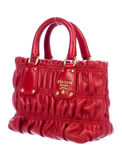 6c8307bc67a1 Prada Mini Nappa Gaufre Crossbody Bag - Handbags - PRA227741   The ...
