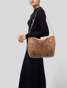 60a1d62788950 Prada Handbags