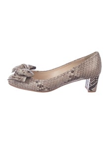 51ae3ad83d9 Prada. Embossed Bow Pumps